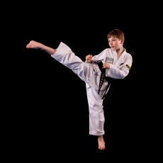 My name is Michael, but some people call me Misha. It has helped me become a more responsible person. With every degree achieved, Taekwondo is helping me become stronger. Other than Taekwondo, I like to swim and play chess!